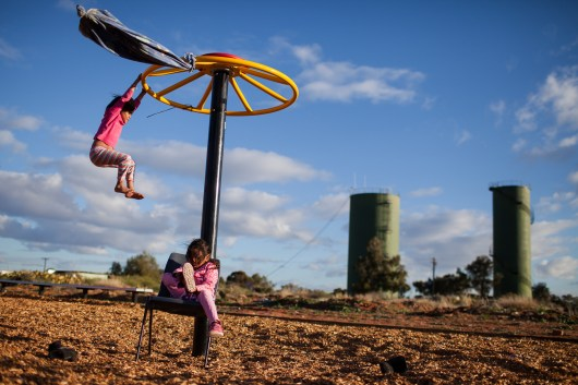 Young children play on the newly built community playground. The playground was payed for by the international aid agency Save The Children. David Maurice Smith/Oculi.
