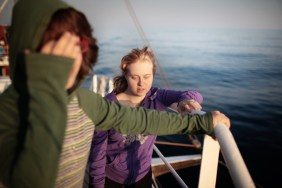 Annalisa enjoys the sea breeze at the sun set on board of Nave Italia - the third, in weight order, sailing school of the Italian Navy corps. Since 2006, Rome's branch of the Italian Association of People with Down syndrome is running a sailing program for young adults. Rather than being a sailing school, the program uses the boat environment to challenge the adaptive skills of its participants. In 2012 a group of the eight most proficient users were selected to join up with the official team of Mascalzone Latino to participate, on board of La Poste as a mixed crew, for the historical Barcolana sailing race. La Poste scored and amazing 24th position among more than 1000 participants.
