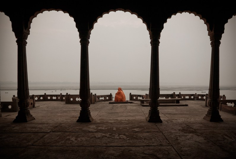 Varanasi, India: A pilgrim man is meditating in a deserted palace. © Matjaz Krivic