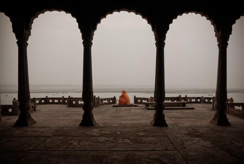Varanasi, India: A pilgrim man is meditating in a deserted palace. © Matjaz Krivic