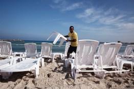 Eritrean worker on the beach in Tel Aviv.
