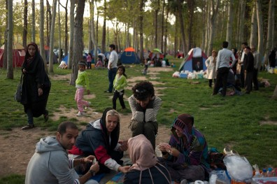 "TEHRAN, IRAN: Sasan, Amir and his family celebrate the national holiday of ""13 be dar"" by picnicking in Eram Park. Amir's family have been very supportive of who he is. They are no stranger with the gazes and humiliation the face in public on a daily basis."