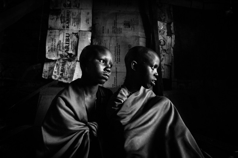 Maasai-girls Isina & Naserian are sitting in their father's hut a day before their planned circumcision.