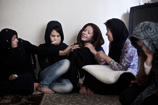 Afghan women of three related families mourn the loss of loved ones who disappeared and most probably drowned trying to cross the river Evros between Greece and Turkey in an attempt to reach the safety of Europe, Athens, Greece, May 26, 2012. The group of thirteen tried to cross the river in the night from May 20 to 21, 2012 in a cheap rubber boat. Only one of them could swim. When the boat lost air and finally drowned in the middle of the river, five of the thirteen did not make it to the other side. Homeira Hasanpur (second to left) lost her husband. Fatima Rahimi (third to right) lost her 22-month-old son, her sister Parwin Rahimi (second to right) lost her 4-year-old daughter. Zohra Shafai (right) lost her 7-month-old son. The land border between the two countries has become the main illegal entry point for refugees going to Europe according to Frontex, the European Union's border policing agency. In 2011 that amounted to more than 55,000 people who were detected, a 17 percent rise from the year before.