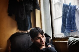 Najib, 17, an Afghan refugee, looks out of a window in an apartment close to Omonia Square in downtown Athens, Greece, April 14, 2012. Najib fled Afghanistan more than two years ago because he was threatened by neighbors who fought with his family over land and Taliban who wanted to take revenge for his older brother being in the military. Unable to go to school, work or even leave his home, he fled to Europe seeking a safe life. Now he is one of thousand of Afghan and other refugees stuck in Greece with slim chances to get Asylum here or travel to another European country. Najib shares one room with 12 other Afghans in a back alley where heavy drug use and prostitution are rampant. Najib shares one room with 12 other Afghans in a back alley where heavy drug use and prostitution are rampant. Najib crossed the river Evros between Turkey and Greece about a year earlier. The land border between the two countries has become the main illegal entry point for refugees going to Europe according to Frontex, the European Union's border policing agency. In 2011 that amounted to more than 55,000 people who were detected, a 17 percent rise from the year before.