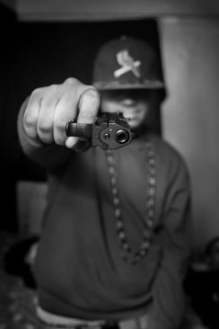 8) Murder hold a gun that he bought for 250$ in the street, he bought it after guys from another gang stabbed one of his friends in the neck.