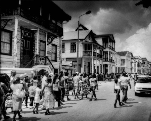 """Creole and Maroon residents of Parimaribo walk in the historical riverfront district celebrating the Keti Koti (""""Cut Chain"""") Slavery Emancipation day in Suriname. Maroons celebrate the holiday, though their ancestors escaped from slavery, while Creoles suffered from slavery until Keti Koti Emancipation on the first of July in 1863, though there was a 10 year transition period until 1873 when all slaves could walked off of the plantations as free people."""