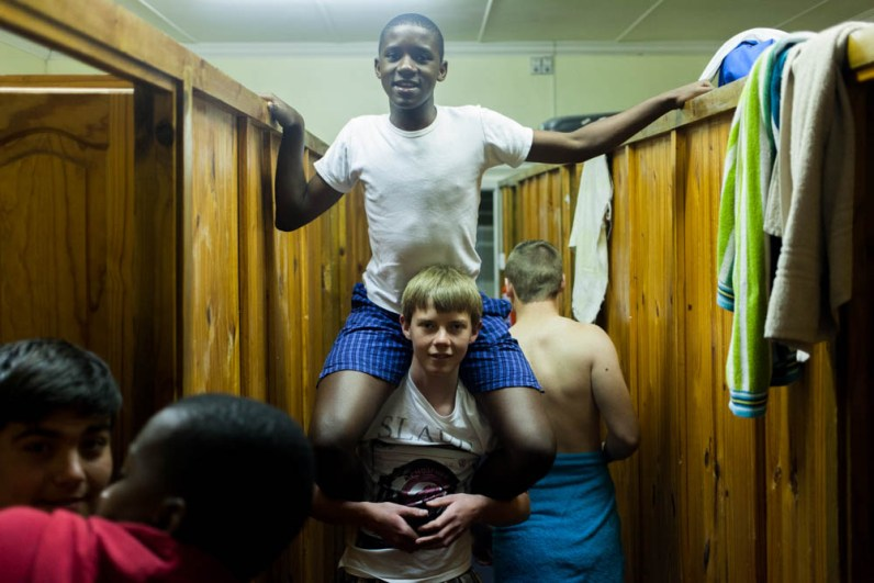 Inside Queens college, roommates in a boys hostel. Queenstown. 2014
