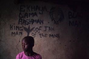 Saneliswa Mthebu, 8 year old girl in her uncle's room. 2014