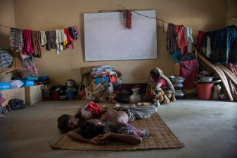 A flood-affected family takes shelter at a school at Tala in Satkhira.