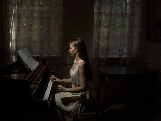 """""""This picture of the pianist was taken in Mariupol in June 2015, at the school of music during the rehearsal for the end of year examination. In photography I always look for the very narrow boundary within visible reality and intimacy with people, the moment in between fascination for a subject and its rational understanding. It's what I call a relation of intimacy."""" - Jérôme Sessini"""