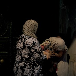 A muslim woman is supported by her mother and sister as she suffers from tear gas fired by riot police against protesters, next to Istiklal street in Istanbul, Turkey.