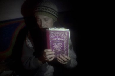 A resident of Debaltseve holds on to her bible while taking shelter from shelling in the city center. Debaltseve was the scene of intense fighting and shelling between Pro Russia rebels and UA army, leaving many civilians stranded in between.