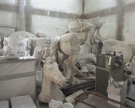"""9.12.2015, Skopje, Macedonia. Mockups of monuments ordered by the state, including infamous """"Warrior on the horse"""" in the workshop of sculptor Valentina Stefanovska."""