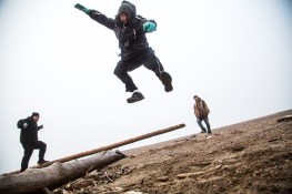 For now, Alaska's Arctic Coast remains treeless. Driftwood from more temperate places accumulates on the beaches. Sonny Boy Leavitt is assisted in flight by Suvlu Woods and George Sam. Napaqsralik.