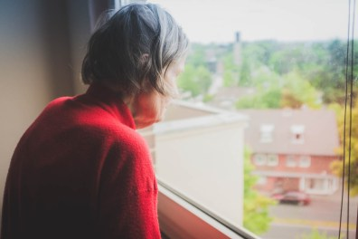 Helga looking out of her living room window. This day Helga was moved out of the apartment in which she had lived in for 55 years, to be admitted into a closed medical facility. Neuss, GERMANY, May 29, 2015.