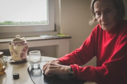 Helga sitting in her kitchen, while her daughter Nicoletta finalises preparations for the departure to the retirement home. Neuss, GERMANY, May 29, 2015.