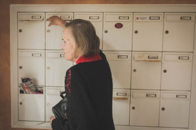 Helga checking her letterbox one last time before moving to the retirement home. Neuss, GERMANY, May 29, 2015.