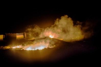 Punta Arena, Baja California, Mexico. fishermen burn trash and carcasses at night.