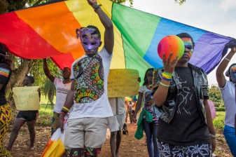 Members of the LGBT community and their supporters participate in a Pride march in a park on the banks of Lake Victoria in Entebbe, 40 km from Kampala. Safety concerns made it impossible to hod the march in a more public location like downtown Kampala. Entebbe, Uganda. August 8, 2015. © Diana Zeyneb Alhindawi