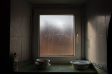 "Ana and I practiced spelling in Cyrillic on the foggy kitchen window. When she and her sisters were deported to Kazakhstan they had to study in Russian. It is a common theme in deportees' stories that they learned and studied in Russian once displaced; many deportees have voiced feeling like their language was taken from them. Some older Moldovans speak Romanian while writing the language in the Cyrillic script, while other deportees lost their native tongue all together and have a hard time speaking in Romanian at all, instead defaulting to Russian. While Ana's Romanian is quite developed, Pasha's struggles slightly more as a result of her living a great deal of her adult life with her husband, Vanea, in Ukraine. Ana remembers, ""I would sit with my head beneath my desk. I couldn't understand a word. I was crying, crying and crying. I couldn't speak a word in Russian. Mother would soothe us in the evening, when she came home. She would say, 'Stop crying now. You will learn. Today a word, tomorrow - two.' We found ourselves taken so far away from our Moldova to such a big country, and we couldn't understand a word of Russian. Mother translated us as much as she could. But that's how it was. What could we do?"""