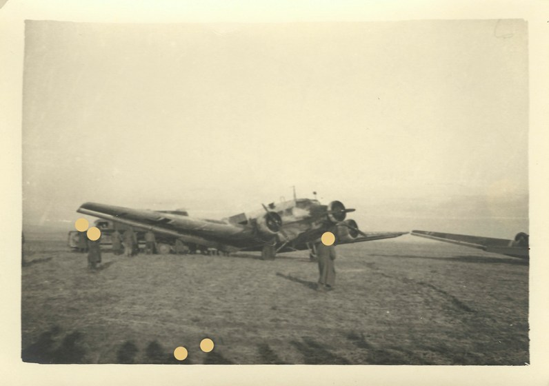 A photo of my grandfather's archive, a german plane in Russia. The dots resemble the holes in my inherited memories.