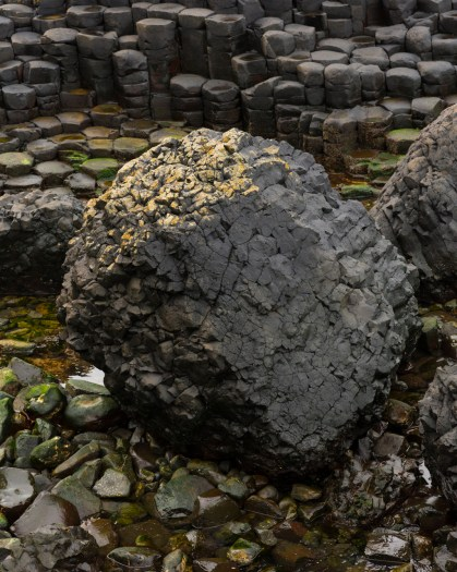 Rock formation in the northern coast of Northern Ireland. A natural phenomenon caused around 50 to 60 milion years ago. Antrim was subject to intense volcanic activity, when highly fluid molten basalt intruded through chalk beds to form an extensive lava plateau. As the lava cooled, contraction occured.
