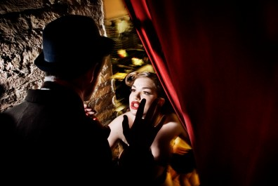 The Italian performer Cherry Bloom, has a heated discussion with her assistant Dandy Wally before entering the scene, backstage at the Micca Club, Rome. May, 2009.
