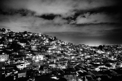 A view towards the Alemão favela, one of several favelas inside the Alemão complex. While officially 70.000 people live, unofficial numbers suggest that up to 200,000 people actually live in the complex. In Rio de Janeiro alone, an estimated 1.5 to 3 million people live in the so called Favelas, the slums that were illegally settled in the city due to the lack of affordable housing. Most people in the favelas live with minimal or no public services, and most of these areas are under the de-facto control of drug gangs or paramilitary forces. May 2009.