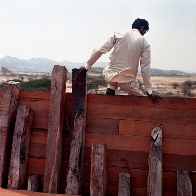 T., a Pakistani worker, climbs down from a Lenj in construction.