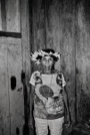 """PANORAMA, BRAZIL - OCTOBER 17, 2017: Katisiká Karipuna portrayed inside her house in the Panorama village. She is one of the four tribespeople who still speaks the Karipuna language. The majority of the tribe was wiped out by diseases following contact with Amazon settlers in the 1970's, during Brazil's military governments' drive to occupy the Amazon. Today the Karipuna population number 40 memebers. The Karipuna Indigenous territory in Brazil's North-western state of Rondonia sits on the so called """"arc of deforestation,"""" the agricultural frontier advancing into the Amazon forest and one of the front lines of the country's deadly conflict over land and resources. Since 2015, the land has been increasingly targeted by loggers and land grabbers but the tribesmen so far say their complaints have fallen on deaf ears. In Rondonia, death threats are serious. The state consistently tops the list of land conflict killings, with 15 already in 2017, according to watchdog group Comissão Pastoral da Terra."""