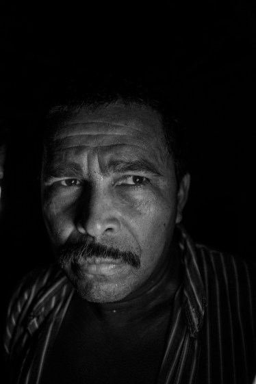 """PARAUAPEBAS, BRAZIL - JULY 20, 2016: Joao Alves da Conceicao (47) is one of the 119 families living in the Frei Henri des Roziers Camp, established by the Landless Rural Workers' Movement (MST) in Aug. 8, 2010. The landless peasants are occupying a 400-hectare estate known as Fazendinha, located off federal highway BR-155 roughly 100 kilometres from the city of Marabá, southern Para. They say that the purported owners of the estate, formerly a cattle ranch, created it by invading and illegally deforesting public land, and that at the time of the occupation, it had been left idle and unproductive. This is the justification for almost all of the land occupations by social movements demanding agrarian reform in Brazil. The occupation of Fazendinha has led to bitter conflicts with local ranch owners, who have joined forces and hired private armed guards to intimidate the landless farmers and destroy their crops, shooting everyday against the houses. This has led half of the families to leave the camp. Joao says: """"This is a lawless state. When the land is power a slide of beef for export has more value than a human life""""."""