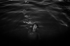 MARABA, BRAZIL - JULY 17, 2016: A boy taking a bath at night in the Tocantins river, a tributary of the Amazon River in the state of Pará.