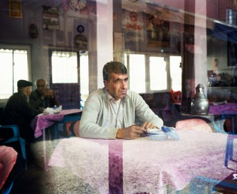 A villager from Hasankeyf is sitting at a café. The Ilisu Dam project due in 2018 will flood 80% of the ancient monuments of Hasankeyf along with 52 other villages and 15 small towns destroying a unique historical site where a mix of Assyrians, Roman and Ottoman monuments belong. Hasankeyf, Turkey