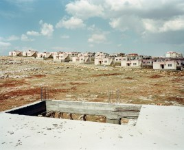 View on the new settlement of Karaotlak. Halfeti is a small farming district on the east bank of the river Euphrates partly submerged in 1999 under the waters behind the dam on the Euphrates at Birecik. The town was therefore removed to the village of Karaotlak (also called New Halfeti) where the residency of the new town is now complete. Karaotlak, Turkey