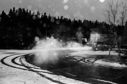 "A ralleycar drives at a selfmade training race course in Varena, the district with the highest suicide rate in Lithuania. Lithuania, Varena, 20th of February 2016. Gintautas, the founder of the local car/youthclub wrote: ""My favorite colors are black and white, so I dive head down, passionately, into all activities I engage in. I strive to help children under my guidance to learn to recognize and be guided by the roadsigns of life as soon as possible."""