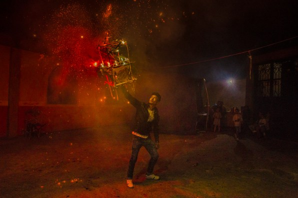 A man burns a torito (fireworks) to celebrate a birthday . Guerrero Mexico. December 29,2018