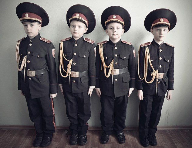Young boys posing in uniform at a military boarding school, Kiev. Since the beginning of the conflict, the number of children sent by their parents to this penitentiary has increased tenfold.