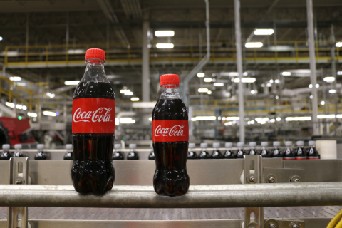 The Coca-Cola mini bottle of 250ml stands next to its 500ml sibling.