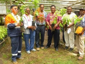 PNGCCIL's Dr. Eremas Tade (3rd from right), and Ramu NiCo's Wang Baowen (left), at the  launch of the cocoa seedlings in Basamuk.