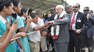 India's Naraendra Modi mobbed by Fiji schoolchildren. Credit: ChannelNewsAsia