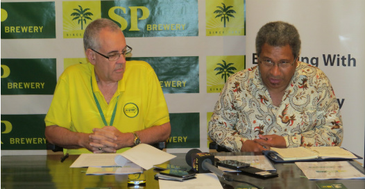 SP Brewery Managing Director Stan Joyce and DAL Department Secretary Dr Vele Pata Ila'ava launch the cassava project. Credit: SP Brewery.