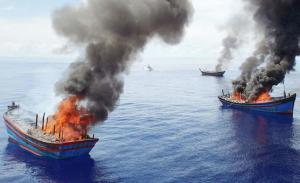 Palau burns illegal Vietnamese fishing boats. Credit: National Geographic