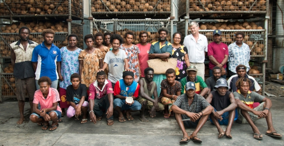 Directors Debra and Dennis Hill with the Niugini Organics team. Credit: Jody Cleaver.
