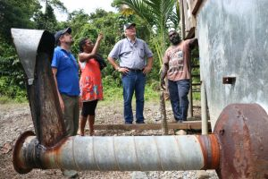 Ishmael Toroama (r) showing one of the fermentaries that he will be rehabilitating. Credit: Australian High Commission