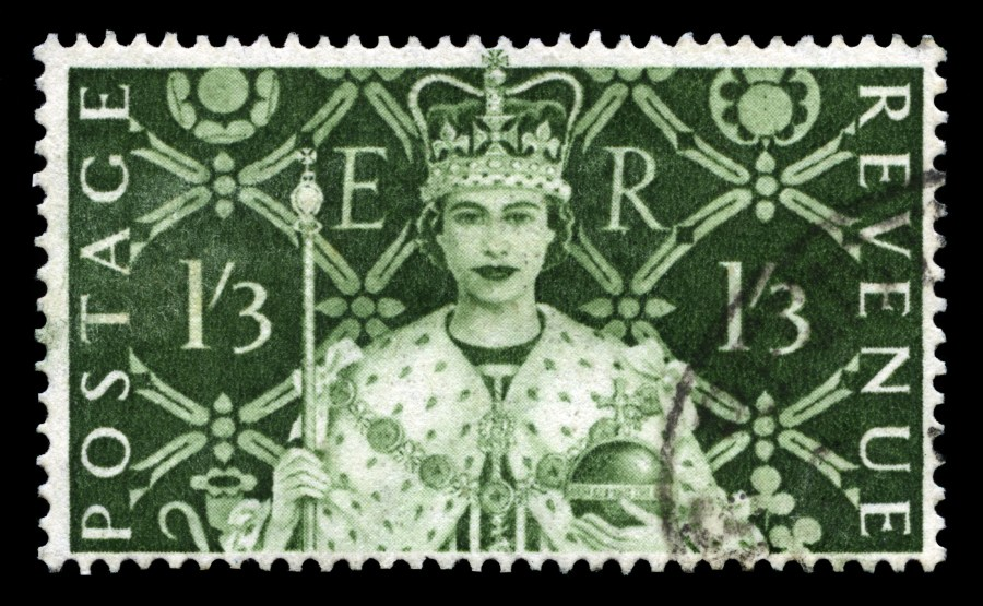 UNITED KINGDOM CIRCA 1953: A vintage British postage stamp celebrating the Coronation of Queen Elizabeth II and a 'Long Live The Queen' postmark circa 1953.
