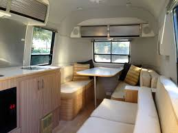 Living Airstream renovates the interior of the campers for vacation or commercial use.