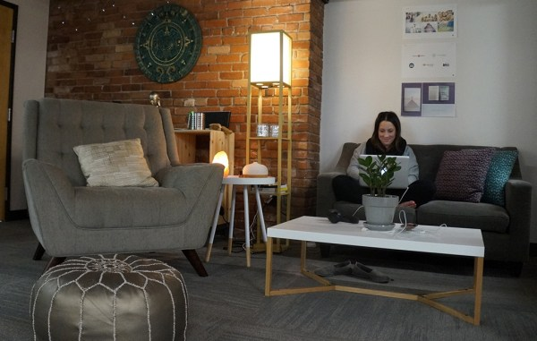 A MeetMindful employee sits in the firm's new office space. (Amy DiPierro)