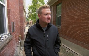 Nylund outside the home as renovations continued. (DIY Network)