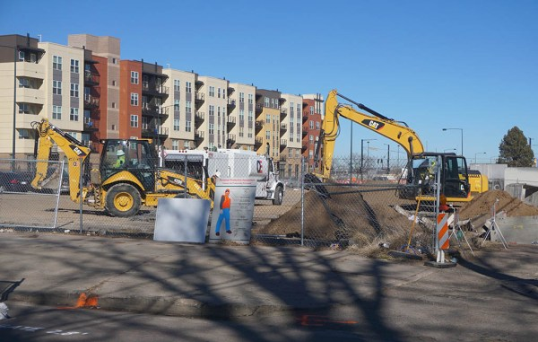 Crews prepare to break ground on a 303-unit apartment building at Broadway and Arizona Avenue. (Burl Rolett)